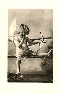 Vintage photo of kid playing Cupid so cute