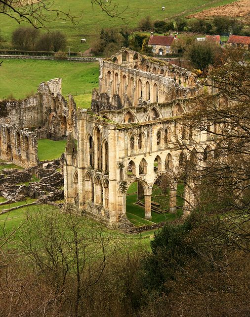 Rievaulx Abbey Ruins, a former Cistercian abbey in Rievaulx, near Helmsley in the North York Moors National Park, North Yorkshire, England. It was one of the wealthiest abbeys in England until it was dissolved by Henry VIII of England in 1538. Originally founded in 1132 by twelve monks from Clairvaux Abbey as a mission for the colonization of the north of England and Scotland.