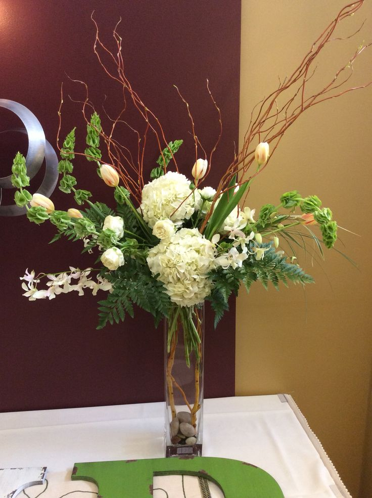 Spring Statement Piece hydrangea, willow, bells of Ireland, tulips, and Hawaiian orchids