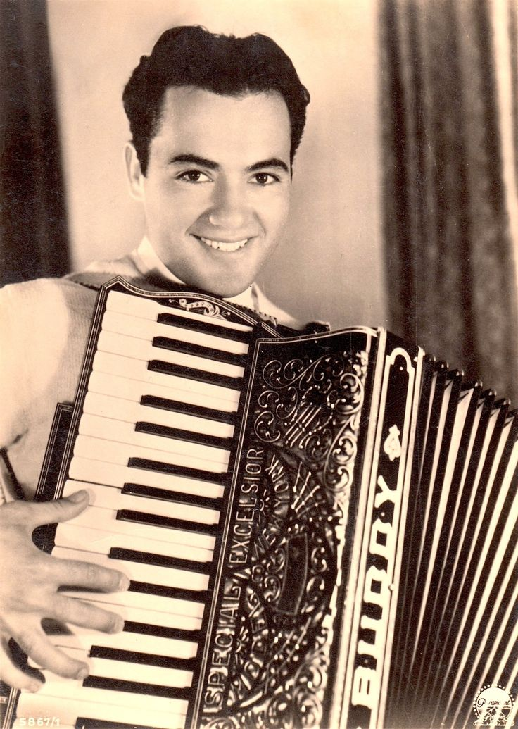 """CHARLES 'Buddy' ROGERS playing piano accordion with his name embossed on it 'Buddy' early 1930's """"ross"""" sepia postcard (sans border)  Silent star, 30's-40's actor/singer/jazz musician/bandleader married silent legend Mary Pickford who was 12 years his senior (please follow minkshmink on pinterest) #buddyrogers #bandleader #silentstar #jazzmusician #pianoaccordian"""