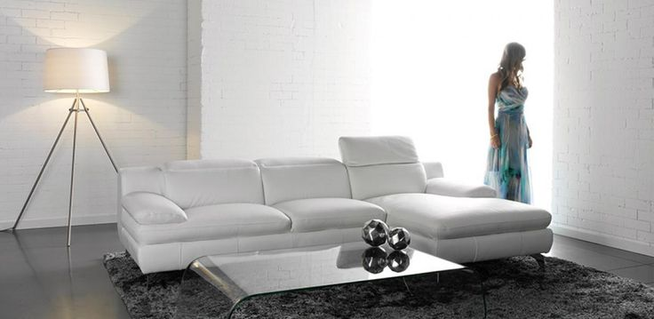 100% Leather Lounge with adjustable headrests.