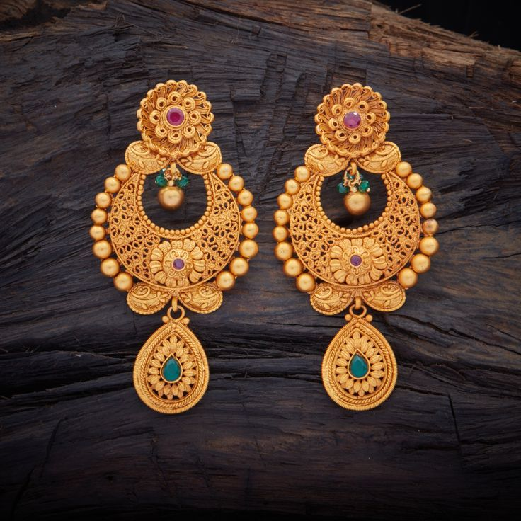 Traditional Designed Antique Hanging earrings studded with Ruby Green synthetic stones, with gold Polish.