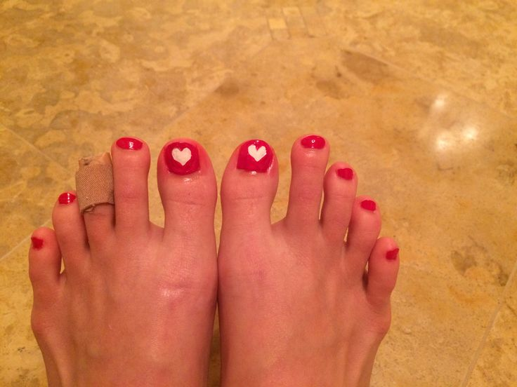 Put a sticker on painted toe then paint over the sticker to have an easy design!