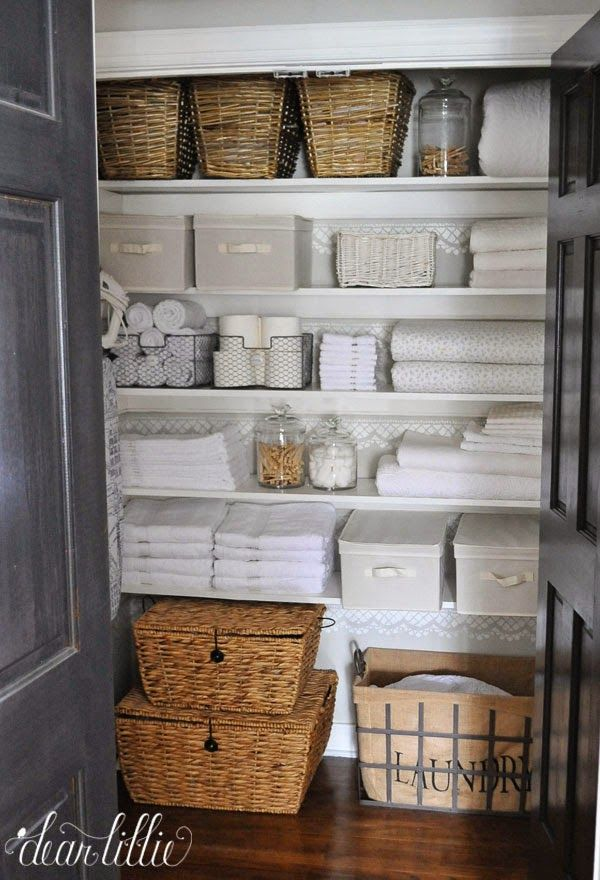 Large stackable baskets like these large ones on the bottom from @homegoods are a great way to store bed linens and a pretty lined laundry basket helps keeps things looking tidy. (sponsored pin)