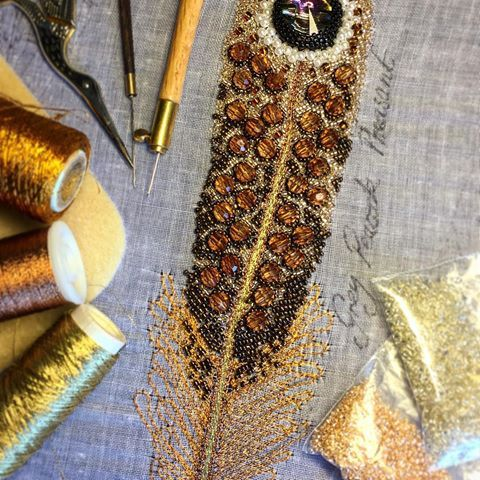 It's been a little while since I have had a beading session, about time I got back to it! Just finished off this Peacock-pheasant feather. .  .  .  .  .  #ceridesignstudio #embroideryart #embroiderystudio #embroidery #beadembroidery #beads #handembroidery #aari #tambour #tambourembroidery #lunevilleembroidery #zardosiembroidery #feather #featherembroidery #artwork #needlework #enbroiderydesign #embroideryinstaguild #stichersofinstagram #beadedart #broderie