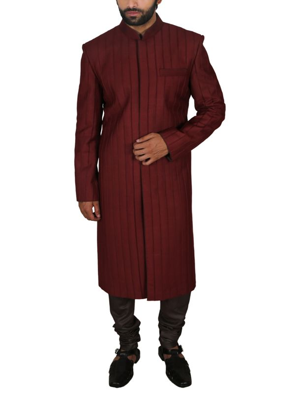 A maroon achkan by Poonam Kasera for a look that is both regal and smart. The…