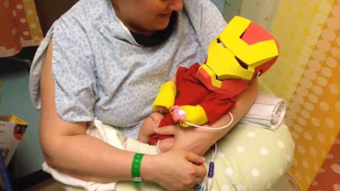 """""""Collier's hooked up to the machines all the time and Iron Man, he built the suit because he needed a machine to keep himself alive,"""" Collier's dad Eric Hart said of his homemade costume for his son, who was in intensive care.   """"I just thought if he had a little Iron Man suit he could come home with us."""""""