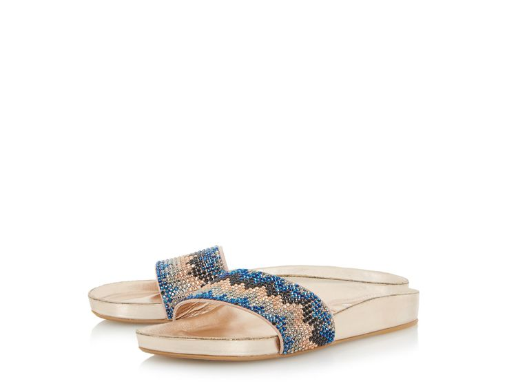 Holiday in style with the Laizer slider sandal, a flat slip on style.  Showcasing