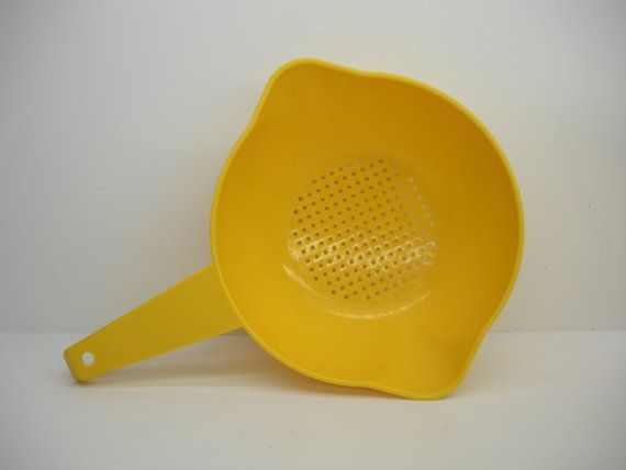 I still have this large yellow colander.  I gave the smaller one to one of my daughters.  :) One Qt Vintage Tupperware Colander  Bright by TheSistersPick