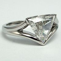 Triangle Diamond Ring featuring a 1.81 carat triangle shaped diamond in a unique platinum mount