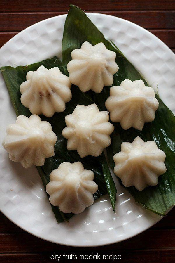 dry fruits modaks are sweet dumplings made from rice flour and stuffed with mixture of mawa, poppy seeds, coconut and dry fruits. #modak #dryfruits