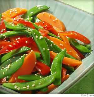 The colorful combination of sugar snap peas, red bell pepper and carrots plus Asian-inspired flavors make this side dish a pleasure to whip up for a weeknight dinner.