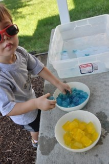 Colored ice cubes for water table play. This acitvity is a good outdoor activity. The children can have fun watching the coloured ice cubes melt into the water and change colours. Also experimenting with colour mixing, seeing how two colours mixed together in the water can create a different color.