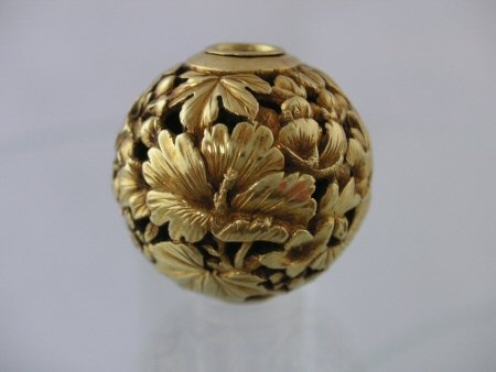 Gold Ojime with Hibiscus Flowers and Bell Flowers amongst Foliage with a small Bird looking out. Pierced Design of the best quality. Height 15mm