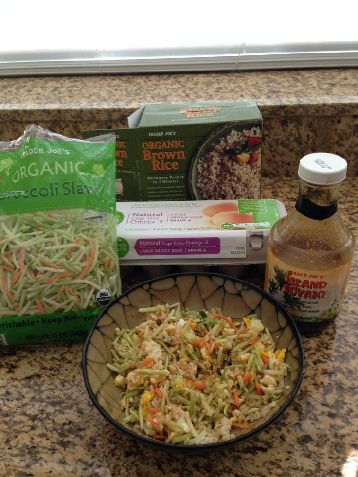 "Healthy ""Fried Rice"" 3/4 cup organic brown rice, 1 cup broccoli slaw, 2 fried eggs and drizzle with Trader Joes Soyaki Sauce"