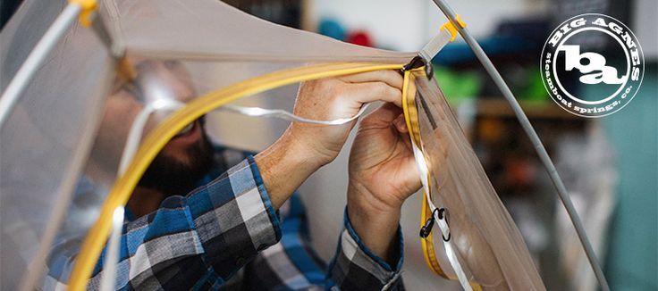 A Big Agnes technician attaches glow lights in the shop
