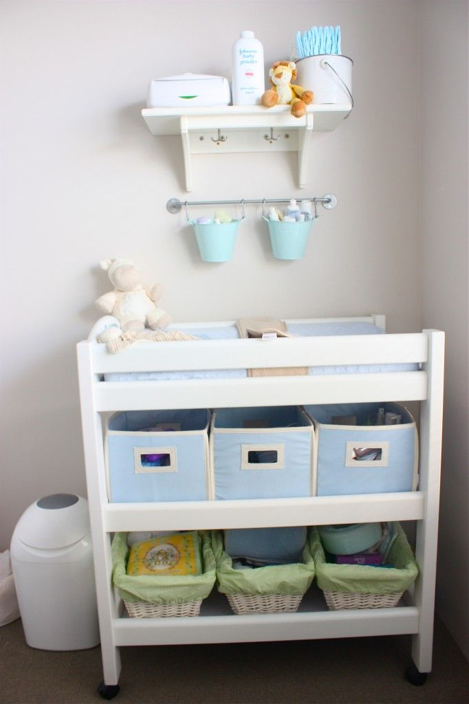 love the idea of hanging pales above changing table to organize/store