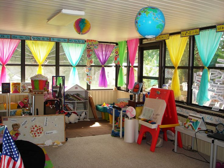 """Our classroom....needs more candy for the """"candy land """" feel, but the curtains give a good start. Curtains are made from plastic table cloths held up with simple tension rods!!"""