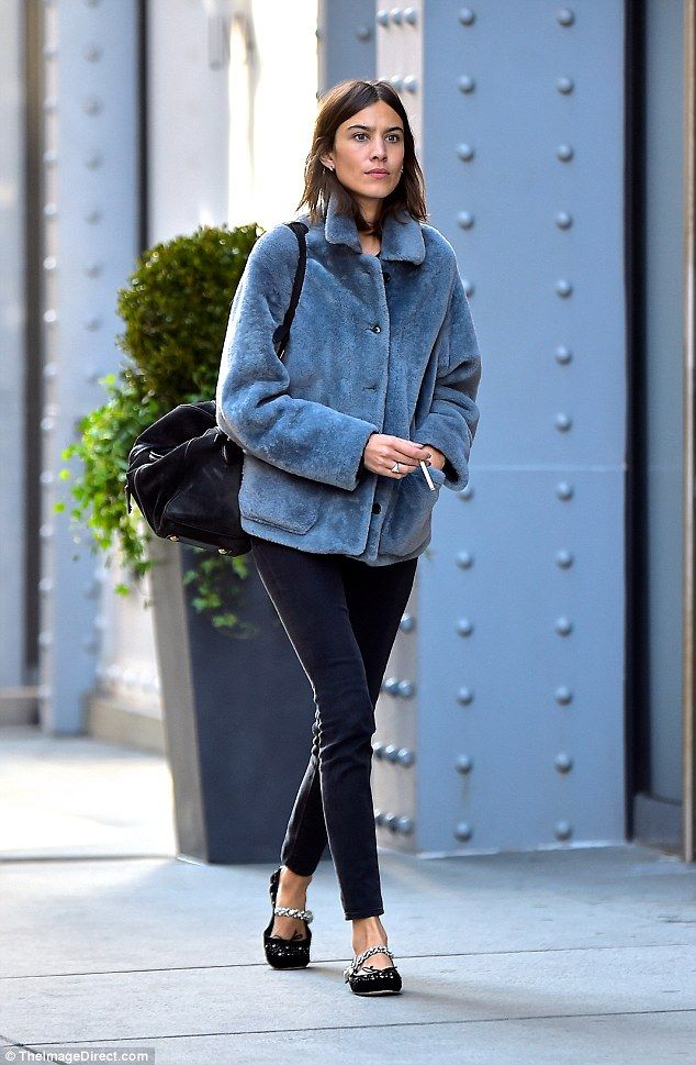 Simply stylish: Alexa nails cosy and cool in faux fur  and signature flats, as she is spotted in New York City this Monday. Fans  the IT girl, author and model can shop a similar look in her latest 'Archive' collection for Marks & Spencer.