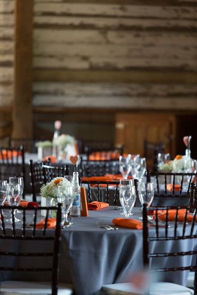 Loving the grey and orange tablescapes for this #barn wedding {eKate photography}