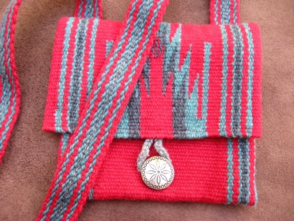 ASpinnerWeaver wove some straps to go with these wool purses from Chimayo, New Mexico.