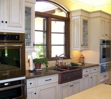 Sinks traditional kitchens and decor on pinterest for Kitchen colors with white cabinets with bronze fish wall art