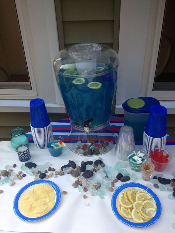 Best blue baby shower punch on the internet. Garnished with gummy sharks and fresh fruit. Eat your heart out, everyone settling for that gross melty duck punch.