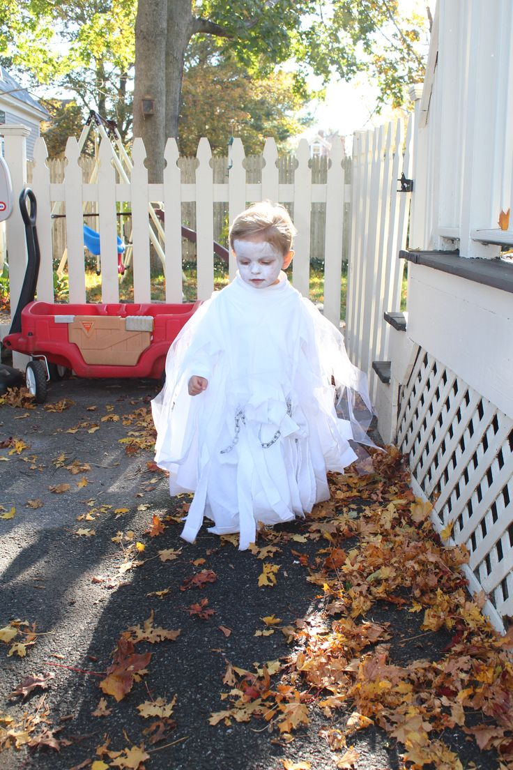 No sew toddler ghost costume: Use white turtle neck and your own pants, cut a hole into a white cotton fabric/sheet, layer over top of turtle neck (you may want to do a few stitches at the shoulders so it stays up), repeat with white tulle, rip or cut fabric/tulle into strips from bottom up, use one of the strips to tie a chain across the body. We had a chain piece left over from hanging a swing in the backyard.