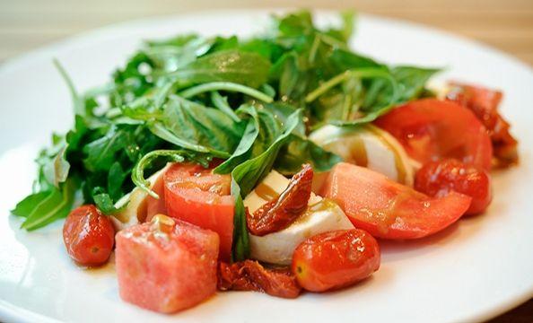 Caprese-watermelon salad with arugula, roasted tomato, mozzarella, sun ...