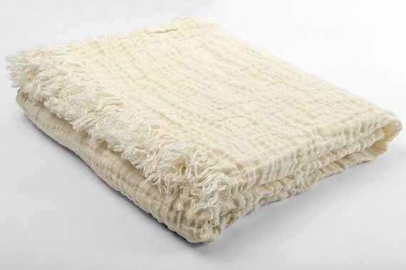 Beautiful pure linen blanket with natural wrinkles in yellowish white colour.Very soft, pure, natural. And beautiful! Made of perfect material, its 100 % natural, breathable, warm and ecofriendly.  Size: 160x 240 cm (plus fringes around 5 cm in shorter sides). Need another size? CUSTOM SEWING available, please send the measurements in private message and I will let you know the price.  The color is yellowish white (white with yellow tone).  Composition: 100 % linen.  Did you know, that…