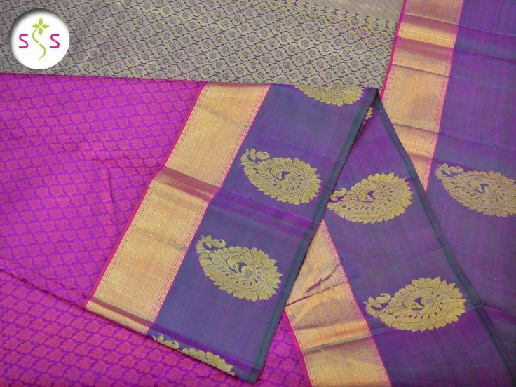 Item : Kanchipuram Pure Zari Saree. Traditional Jacquard With Border Motives Kanjivaram Silk Saree. Pink self-woven motives compliment the magenta body of this pure zari, pure silk, Kanjivaram saree. The border is made up of a thick zari strip with peacock zari motives woven below it.