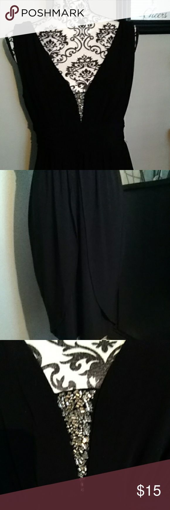 """Formal dress Elegant black dress with deep V front and back. Silver beads detail on the front. Pretty and flattering tulip skirt. Gathered band at the empire waist.bodice is fully lined. Very comfortable.  Worn once to a wedding. About 30"""" from arm pit to hem. Dress Barn Dresses Wedding"""