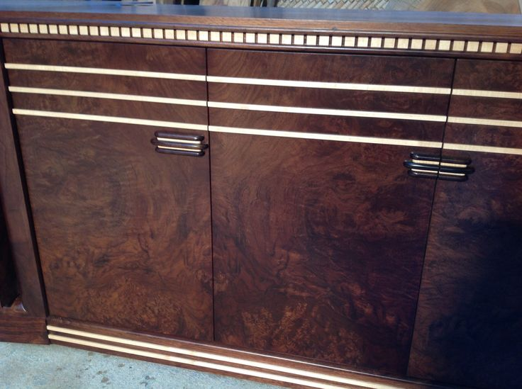 Art Deco inspired burl walnut and rock maple  tv entertainment unit close up on details.