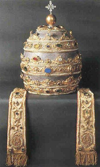 La tiara (del latín, tiara, griego antiguo, τιάρα, persa antiguo, tiyārā o persa, تاره tara) es una mitra alta con tres coronas de origen bizantino y persa que representa el símbolo del papado. Consiste en un birrete cónico o semiovoideo rodeado de tres coronas y del cual penden dos cintas similares a las ínfulas de la mitra.