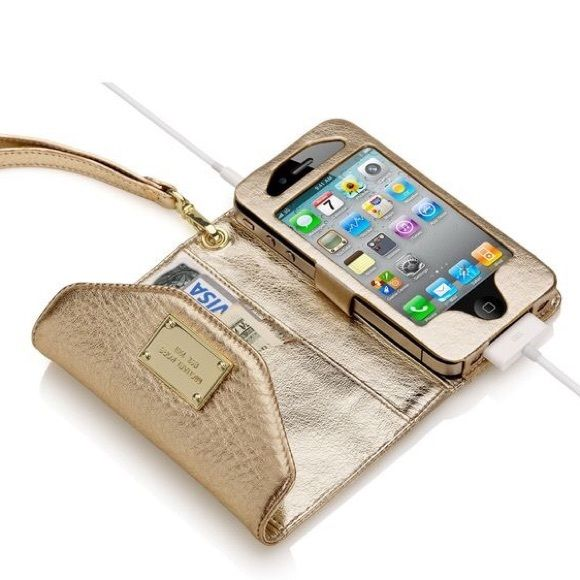 Michael Kors Gold iPhone Wristlet and Wallet This golden colored Michael Kors Wristlet and wallet is perfect for summer style. With a place for the phone and card spots it's a convenient and pretty piece. OFFERS AND BUNDLES WELCOME! Michael Kors Bags Clutches & Wristlets