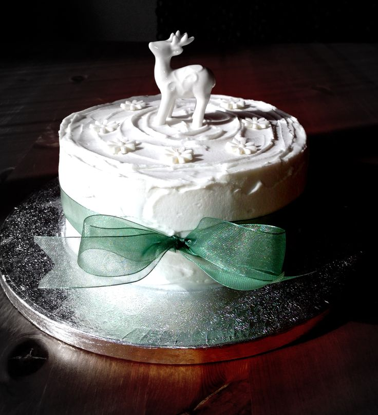 My 2014 Christmas cake: traditional British fruit cake with marzipan and royal icing. Fondant 'snowflakes', ceramic reindeer, ribbon.