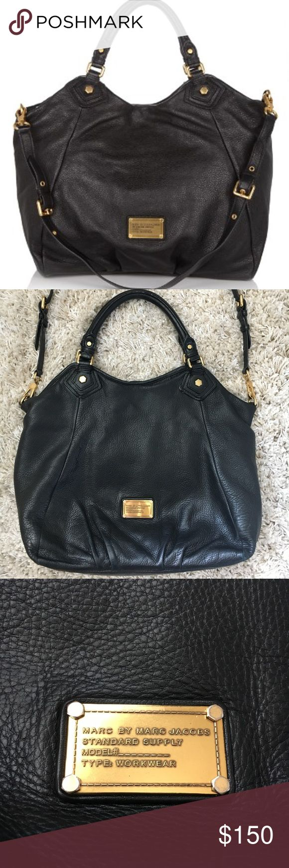 MARC BY MARC JACOBS Classic Q Franc Black Pre-Owned MARC BY MARC JACOBS Classic Q Franc in Black   Normal wear and tear from everyday but otherwise in very good condition (see pictures): Slight wear on the handles  Very slight wear on the buttons attached to the handles Standard make up stains in the inside liner Marc By Marc Jacobs Bags
