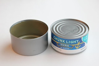 "use a tuna can as a cake tin for a mini 4"" cake. clean it out good first!! smart...."