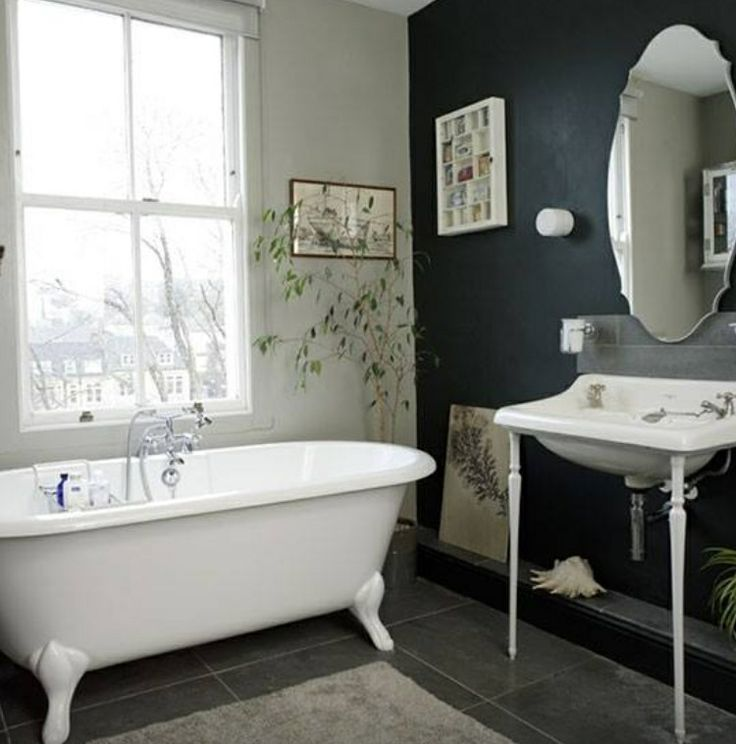 Add drama to your bathroom with a black painted wall/ by Ideal Home