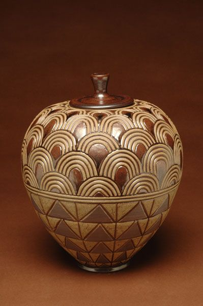 """David MacDonald, """"Large Covered Jar. """" Early, MacDonald turned to his African heritage for inspiration. Examples of surface pattern and decoration found in textiles, utilitarian objects, body ornament, and architecture among the diverse ethnic groups of sub-Saharan Africa continue to inform MacDonald's work on many levels."""" See more of MacDonald & his pottery on his site: http://davidmacdonaldpottery.com/about.html"""
