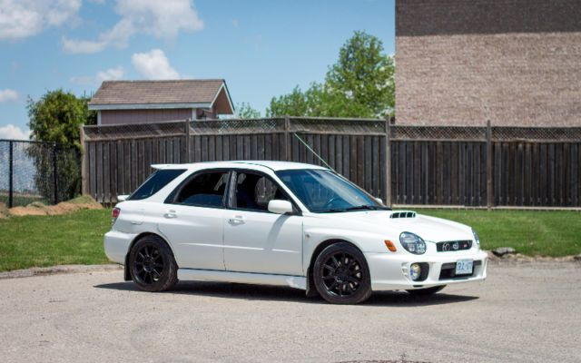 up for sale is my 2003 subaru impreza wrx sti swapped wagon. all work was professionally done, including the swap. it is a unique car that features a full sti sedan widebody (front & rear). the car is lightly modified (intake & catback exhaust), otherwise all stock. never abused and never tracked. recently had all fluids changed (transmission, diff, engine, coolant etc.