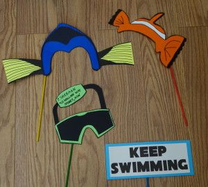 We used card stock and dowels to create our Disney photo booth props. These props were inspired by Nemo and Dory from Finding Nemo.  Disney Photo Props |Disney Party | Disney Party Ideas | Disney Party Decorations |