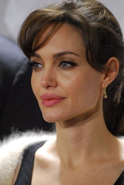 Angelina Jolie with curled bangs. Eye makeup: dark on top lid, light on bottom