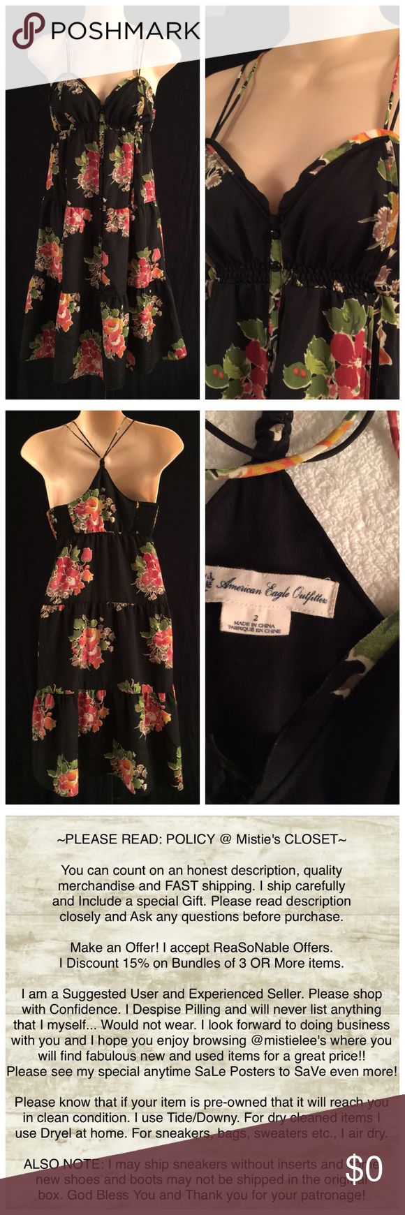 "AE Outfitters Silky Summer FuN Sun Dress Size  2 Made by: AE Outfitters Size 2 Black Floral w/Summer Corals Sweetheart Neckline with extra crude edge hem design Double Tiny Strap Racer Back Style Silky Polyester Button Front Empire Waist Drop Layer Sun Dress. Back has Elastic Sides for a perfect fit. Chest and back are lined. Measurements: Underarm to Underarm 16""+Stretch Elastic Underarm to Hem Length 27"". Pre-Loved: Very Sweet! No signs of wear. Excellent condition. Thank you for browsing…"