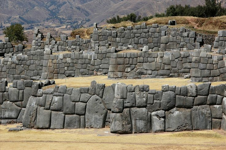 Sacsayhuamán is a walled complex on the northern outskirts of the city of Cusco, Peru, the former capital of the Inca Empire. The complex is made of large polished dry-stone walls, each boulder carefully cut to fit together tightly without mortar.    http://www.fotopedia.com/items/anboto-PCOR-zDbHQc