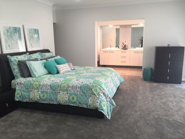 One of our customers, Julie, has shared a photo of the Master Bedroom in her Bronte Farmhouse Grande Manor. Her home is styled with a neutral backdrop and splashes of peacock blue and citrine yellow. For details on this design see http://mcdonaldjoneshomes.com.au/home-designs/new-south-wales-and-queensland/bronte/floorplans. #bedroom #masterbedroom #colour #neutral #neutralbackdrop #citrine #peacock #blue #yellow #acreage #farmhouse #bronte #design