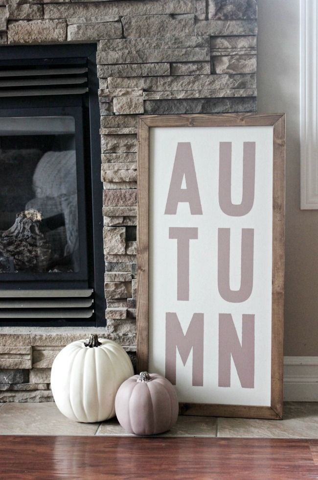 Fall Home Tour - Love Create Celebrate. LOVE this Autumn sign with the matching pumpkins! Perfect way to add height to the fireplace!