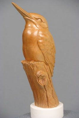 The completed carving after oiling, waxing and mounting on a cast marble base