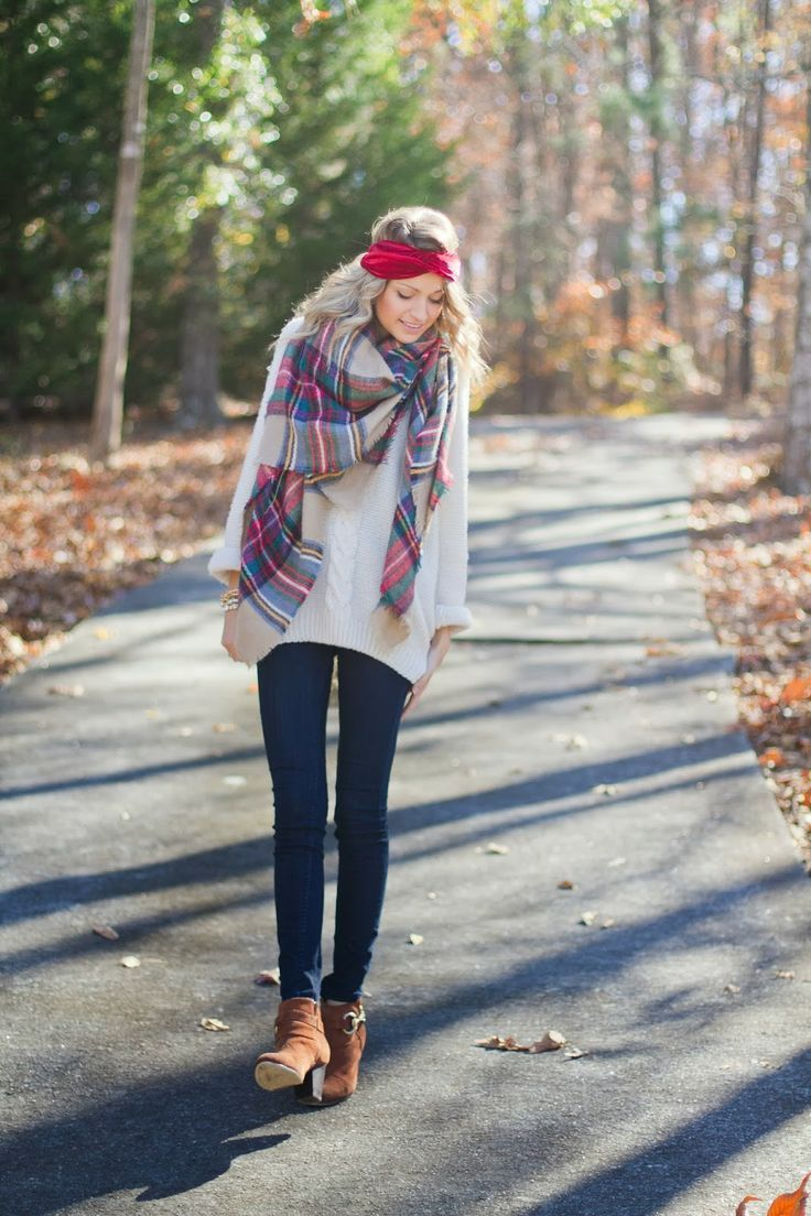 Shop this look on Lookastic:  http://lookastic.com/women/looks/headband-scarf-oversized-sweater-skinny-jeans-ankle-boots/6688  — Red Headband  — Red and White Plaid Scarf  — White Oversized Sweater  — Navy Skinny Jeans  — Brown Suede Ankle Boots