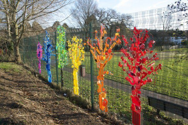 "Rainbow trees using upcycled plastic | Anya Beaumont ""Recently I worked with children from a local primary school to create this beautiful installation of rainbow trees. Initially I asked the children and staff to bring in any non-recyclable plastics they had at home or in school.... I talked to the children about the importance of thinking about what happens to an object after it has been used, and whether we really need many of the plastic items that seem to break so easily. We also…"